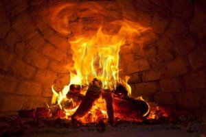 10350311-flaming-bonfire-in-front-of-brick-wall